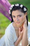 Young woman with spring flowers in her hair Stock Photo