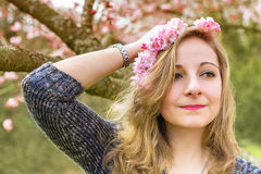 young woman with spring flowers Stock Photo