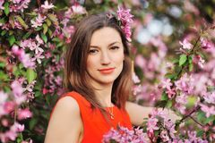 Young woman in spring garden Royalty Free Stock Image