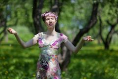 The  young woman in spring garden Stock Image
