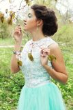 Young woman at spring garden, wearing long dress Royalty Free Stock Image