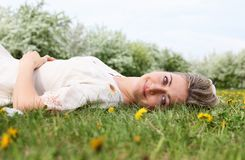 Young woman in spring park Royalty Free Stock Image