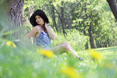 Young woman in spring park Royalty Free Stock Photo