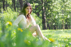 Young woman in spring park Royalty Free Stock Images