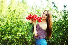 Young woman in spring Park with tulips stock image