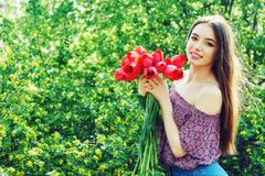 Young woman in spring Park with tulips stock photos
