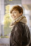 Young woman in spring sunshine. Outdoor portrait of young woman wearing leather jacket in spring sunshine Stock Photography