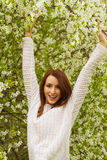 Young woman with spring trees Royalty Free Stock Photos