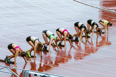 Young woman sprint start Stock Photo