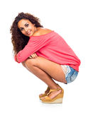Young Woman Squatting Royalty Free Stock Photo