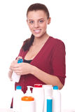 Young woman squeezing the cream on his hand Royalty Free Stock Images