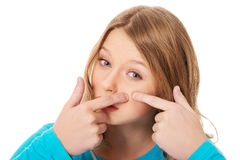 Young woman squeezing pimple Royalty Free Stock Photos