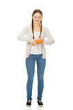 Young woman squeezing a sponge. Royalty Free Stock Images