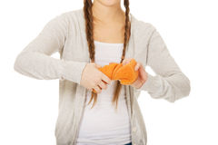 Young woman squeezing a sponge. Royalty Free Stock Photography