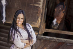 Young woman in the stable Royalty Free Stock Photo