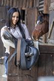 Young woman in the stable Stock Photography