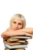 Young woman and stack of books Royalty Free Stock Image