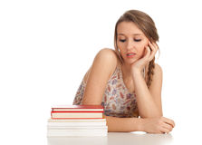 Young woman with stack of books Royalty Free Stock Photography