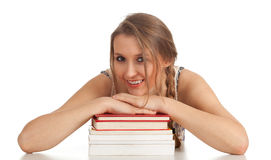 Young woman with stack of books Royalty Free Stock Photo
