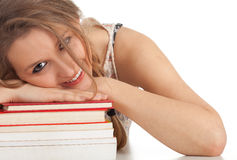 Young woman with stack of books Royalty Free Stock Photos