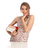 Young woman with stack of books Stock Photography