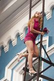 Young woman on stair Stock Image