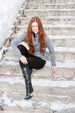 Young  woman on a stair in winter in a park Royalty Free Stock Images