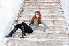 Young  woman on a stair in winter in a park Royalty Free Stock Photo