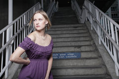 Young woman on a staircase Royalty Free Stock Photography
