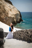 Young woman on the stairs, Santorini Stock Photos