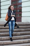 Young woman on stairs Royalty Free Stock Images