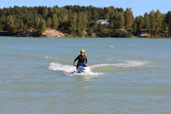 Young woman stand on the jet ski. Royalty Free Stock Photos
