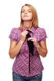 Young woman standing adjusting her tie Royalty Free Stock Photo