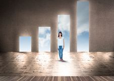 Young woman standing against bar graph shape doorways stock photo