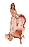 Young woman standing on armchair. Royalty Free Stock Image