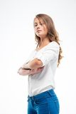 Young woman standing with arms folded Stock Photography