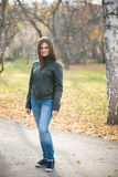 Young woman standing in autumn park Stock Images
