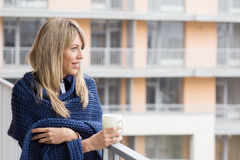 Young woman standing on balcony Royalty Free Stock Image