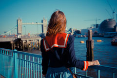 Young woman standing on the bank of the Thames Royalty Free Stock Photography