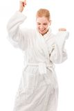 Young woman standing in bathrobe and celebrating success Stock Photos