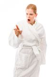 Young woman standing in bathrobe looking anger and pointing Stock Photography