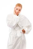 Young woman standing in bathrobe looking worried Stock Photography