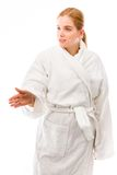 Young woman standing in bathrobe and offering hand for handshake Stock Photography