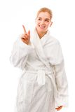 Young woman standing in bathrobe and pointing upward Royalty Free Stock Image