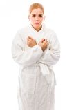 Young woman standing in bathrobe and shivering Stock Images