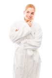 Young woman standing in bathrobe and smiling Stock Photos