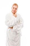 Young woman standing in bathrobe and smiling Stock Image