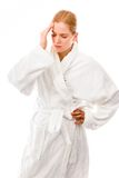 Young woman standing in bathrobe suffering from headache Stock Images