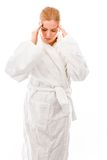 Young woman standing in bathrobe suffering from headache Royalty Free Stock Photos