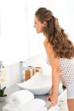 Young woman standing in bathroom Stock Photography